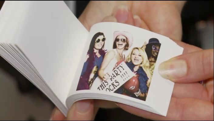 images shows hand holding a photo flip book